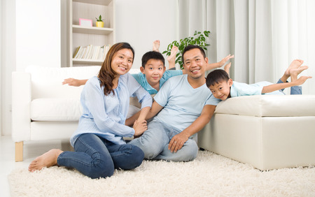 family indoors: Asian family having fun at home Stock Photo