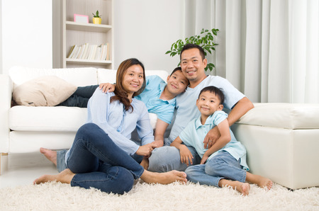mixed family: Indoor portrait of asian family Stock Photo