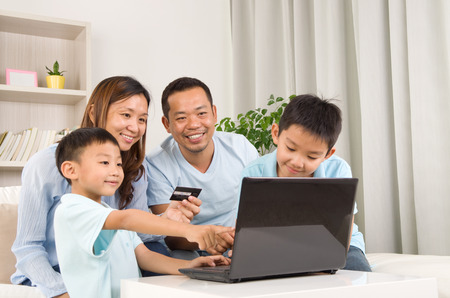 family asia: Asian family using laptop to perform online shopping Stock Photo