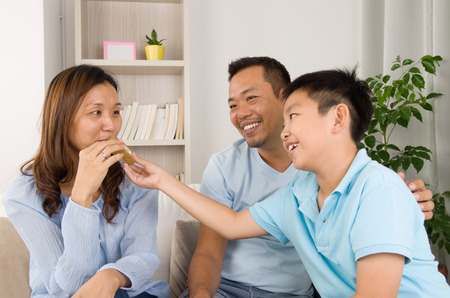 happy life: asian family enjoying snack Stock Photo