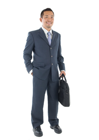 Handsome business man of Southeast Asian, full length portrait. Stock Photo