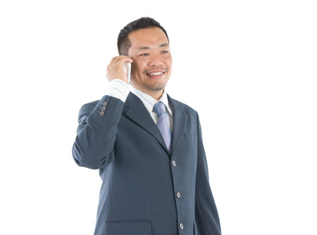 southeast asian: Southeast Asian business man on smartphone communication