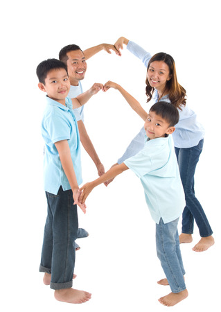happy family concept: Asian family making heart shape with hands Stock Photo