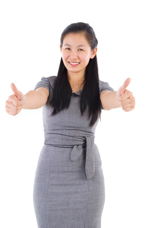 Thumbs up asia businesswoman giving thumbs up over