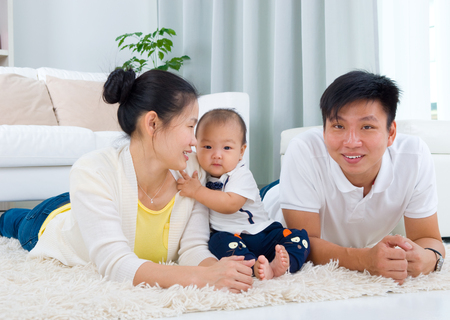 southeast asian: Indoor portrait of asian family Stock Photo