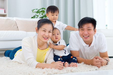 asian toddler: Indoor portrait of asian family Stock Photo