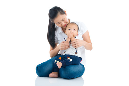 baby love: Asian mother and baby indoor portrait Stock Photo