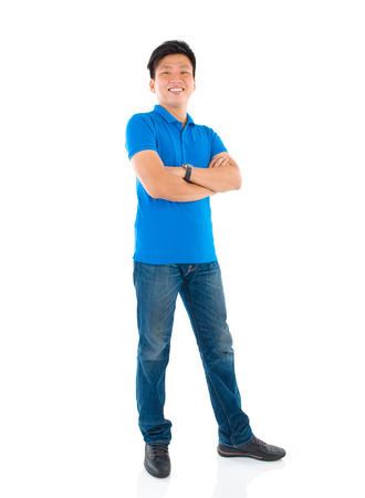 Confident full body Asian man standing isolated on white background 스톡 콘텐츠