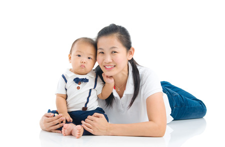 Asian mother and baby indoor portrait Stock Photo