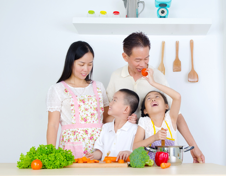 asian cooking: Asian Family cooking in the kitchen Stock Photo