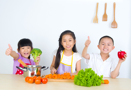 kids having fun with cooking. Healthy eating concept.