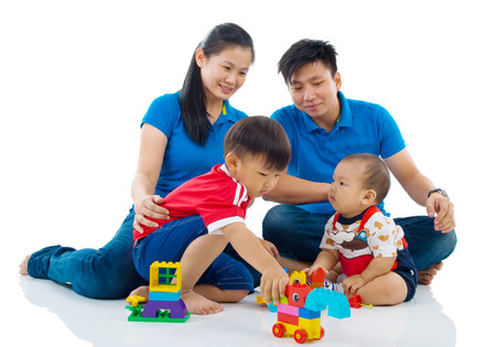 adult family: Asian family playing toys