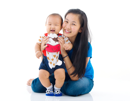 young  family: Asian mother playing with baby boy