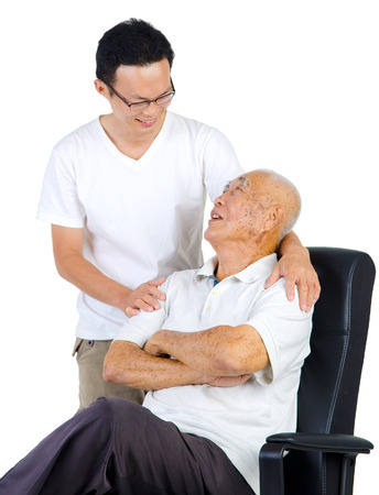 adult son showing concern to his dad Stock Photo