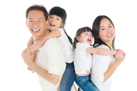 child care: Indoor portrait of beautiful asian family