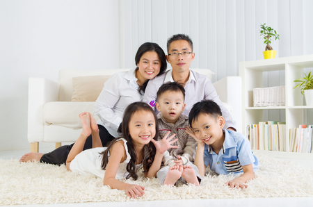 lifestyle home: Indoor portrait of asian family Stock Photo