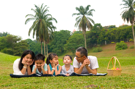 day care: Outdoor portrait of asian family Stock Photo
