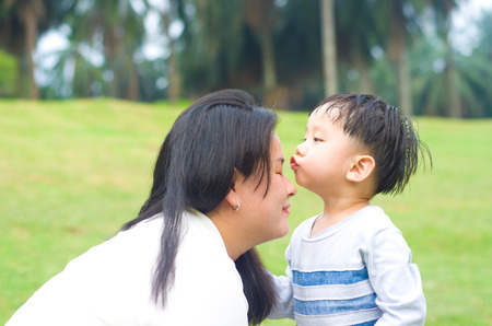 kiss love: Asian mother and son Stock Photo