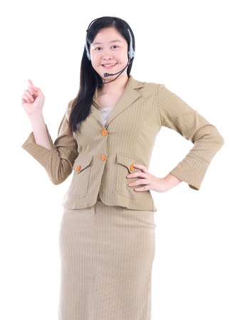 handsfree phones: Friendly Customer Representative with headset smiling during a telephone conversation