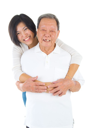 offspring: Senior man and daughter. Happy Asian family senior father and adult offspring having fun time at indoor studio. Stock Photo