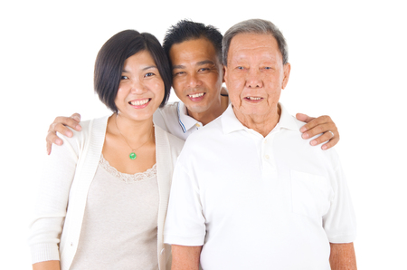 adult offspring: Senior man with his daughter and son. Happy Asian family senior father and adult offspring indoor portrait.