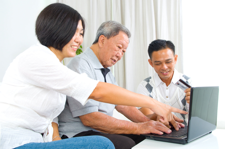 80s adult: Asian senior man learns to use online internet banking Stock Photo