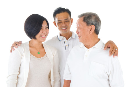 offspring: Senior man with his daughter and son. Happy Asian family senior father and adult offspring indoor portrait.