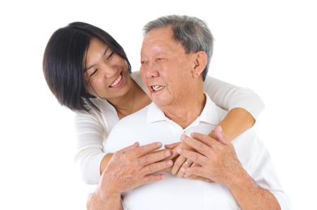 adult offspring: Senior man and daughter. Happy Asian family senior father and adult offspring having fun time at indoor studio. Stock Photo
