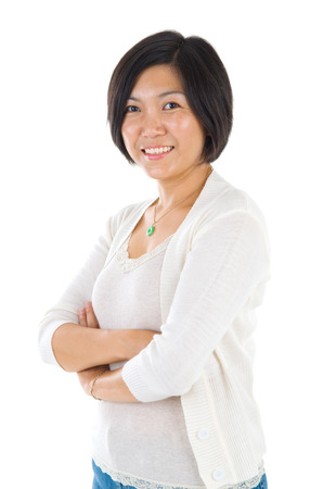 chinese face: Asian mature woman smiling happy portrait. Beautiful mature middle aged Chinese Asian woman isolated on white background.