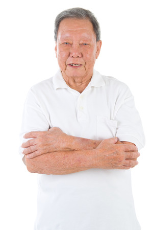 80s adult: Confident arms crossed senior adult asian chinese man standing isolated white background