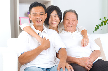 Asian senior father with his adult son and daughter at home. Family living lifestyle. Stock Photo