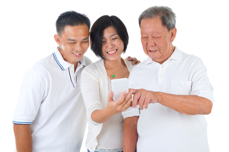 80s adult: Modern technology, age and people concept. Asian senior man with his daughter and son taking selfie, using smartphone, self photographing.