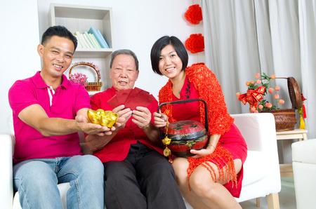 adult 80s: Asian senior man and children celebrating chinese new year