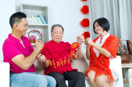 old asian: Asian senior man and children celebrating chinese new year
