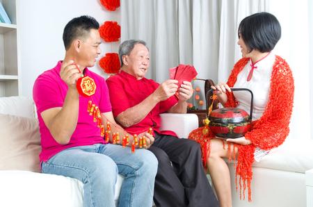 80s adult: Asian senior man and children celebrating chinese new year