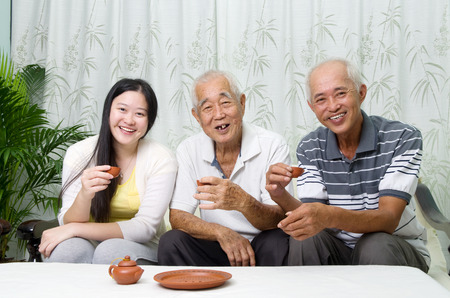 old asian: Asian senior father with his adult son and granddaughter at home. Family living lifestyle.
