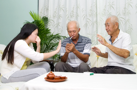 unhealthy lifestyle: Asian father smoking at home. Unhealthy lifestyle or stop smoking concept photo.