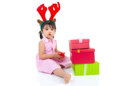 korean girl: lovely asian girl holding an apple and enjoying christmas gift box Stock Photo