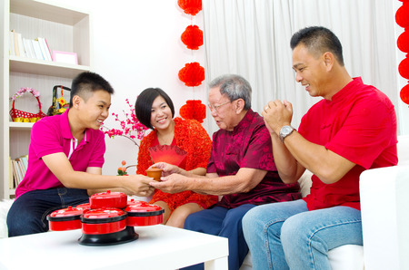 matured: Asian three generations family celebrate chinese new year