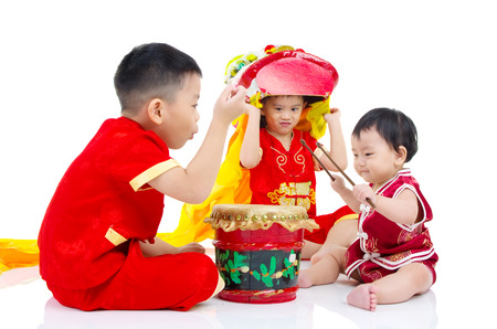 girl in red dress: Asian Chinese kids in traditional Chinese cheongsam celebrating chinese new year , isolated on white background. Stock Photo