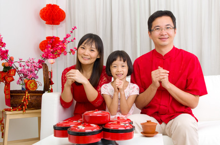 in years: Asian family celebrating chinese new year