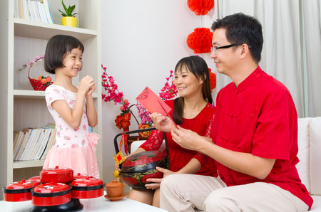 celebrate year: Chinese girl wishing his parent a happy chinese new year Stock Photo