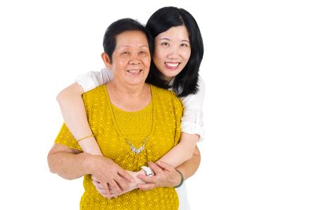 adult offspring: Senior woman and daughter. Happy Asian family senior mother and adult offspring having fun time at indoor studio.
