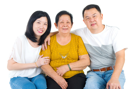 adult offspring: Senior woman with her daughter and son. Happy Asian family mother and adult offspring indoor portrait.