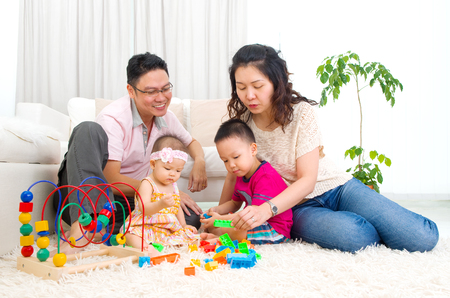 children learning: Asian family playing toys