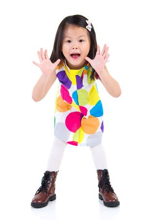 eyes open: Excited asian little child open her mouth and raising her hand Stock Photo