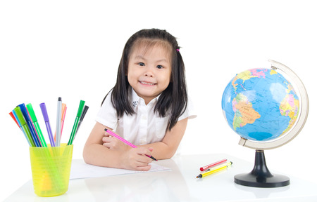 intelligently: Lovely asian girl drawing with colored pencil Stock Photo