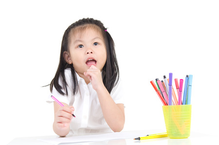 intelligently: Portrait of lovely girl with  colored pencil thinking of what to draw Stock Photo