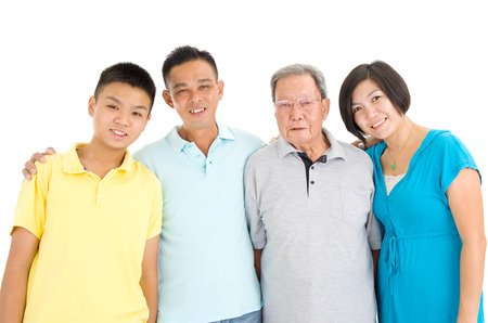 80s adult: Indoor portrait of beautiful asian 3 generations family over white background