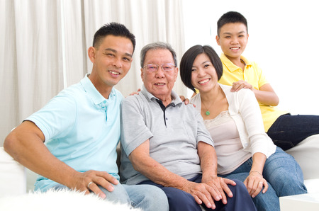 Indoor portrait of beautiful asian 3 generations family Stock Photo